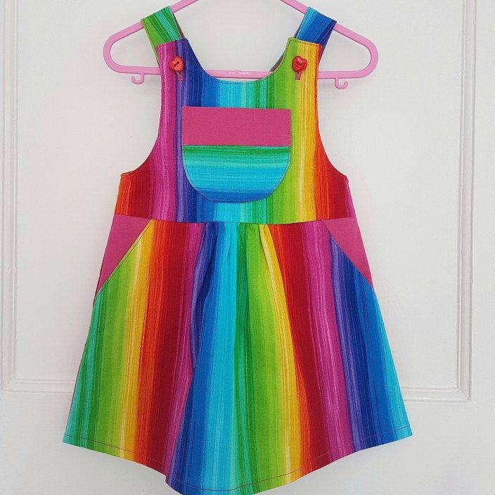 Stunning new rainbow dungaree dress. Perfect for making happy memories.