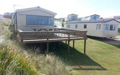 8 berth caravan for rent with private balcony, situated on the Haven site at Perran Sands, Perranporth in Cornwall.