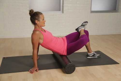 Using the foam roller to stretch tough places!