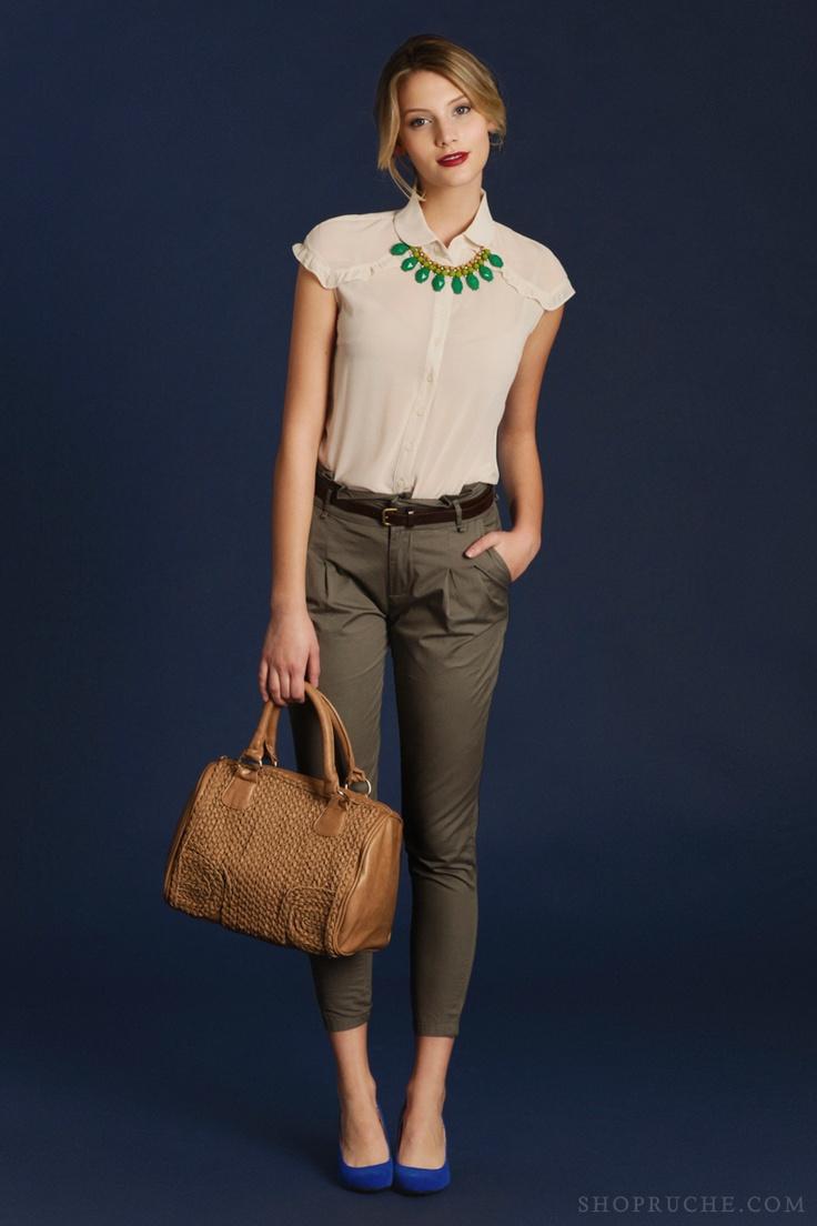 green necklace, white blouse, khaki pants, bright blue heels