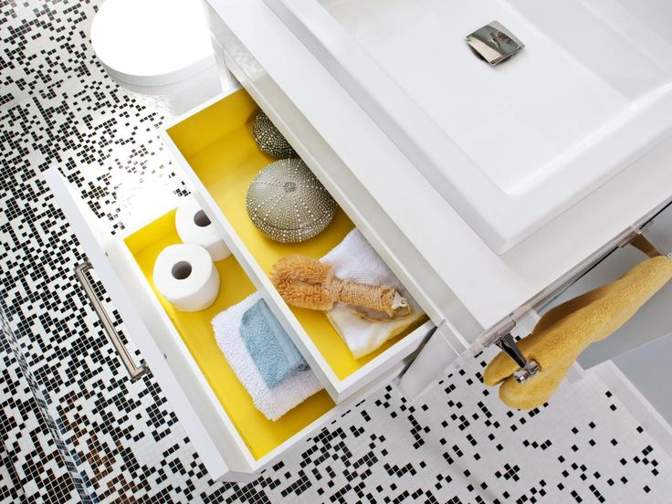 Add an unexpected splash of color to the inside of your vanity, dresser or nightstand drawers by painting them a bold hue, like this shade of vibrant yellow. Design by Gregg De Meza, Jennifer Gustafson and Michelle Nelson of De Meza Architecture + Interiors