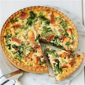 Hot smoked salmon tart recipe. Spread the pastry case with pesto before adding the filling. You can take the leftovers to work the next day.