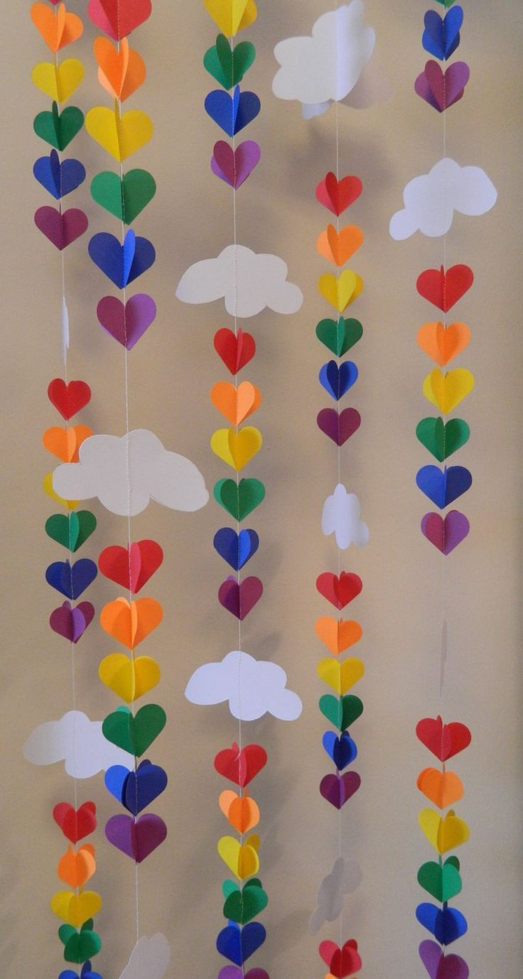 I'm thinking classroom decor! This is such a great idea for my reading corner.  3D Clouds and Raindrop Rainbow Garland
