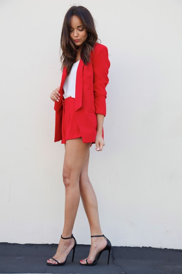 Consider teaming a red blazer jacket with red shorts for a glam and trendy getup. Rock a pair of black leather heeled sandals to va-va-voom your outfit.   Shop this look on Lookastic: https://lookastic.com/women/looks/red-blazer-white-tank-red-shorts-black-heeled-sandals/10946   — White Tank  — Red Blazer  — Red Shorts  — Black Leather Heeled Sandals