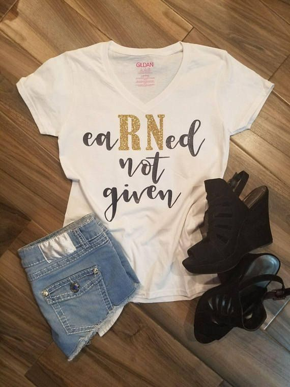 Perfect Shirt for the Nurse in your life! All t-shirts are printed on 100% High Quality (Preshrunk) Cotton Branded T-shirts All t-shirts are custom made to order. Please select shirt size and type from drop down menus. ***All designs are done in Navy Blue or Black and RN in