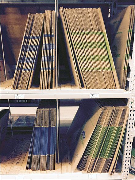 These minimalistic, Do-It-Yourself Pallet Rack Shelf Dividers maintained order among various color-coded offerings of corrugated cartons in a Lowes® building supply superstore. The color coding is ...