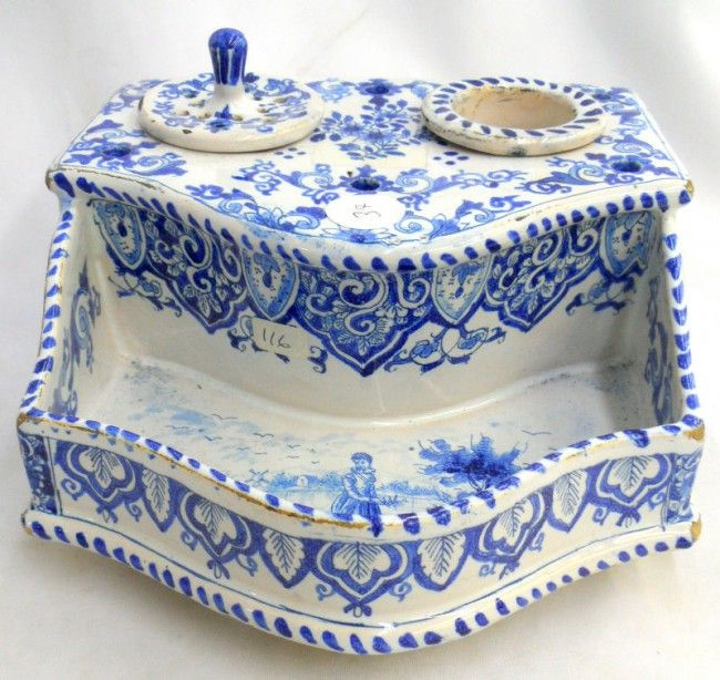 Finely detailed hand-painted cobalt blue and white porcelain inkwell. The body of the inkwell is a hexagonal shape with four feet.