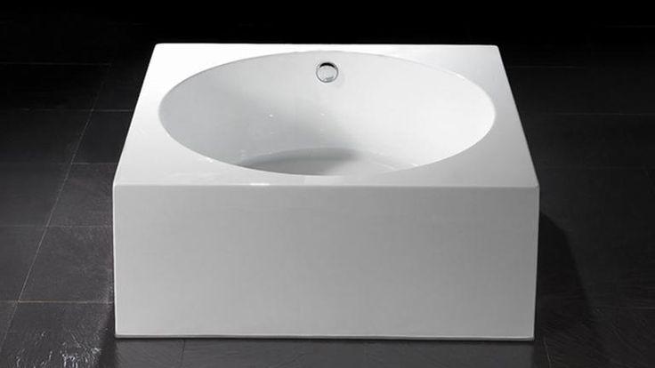 Baignoire lot ronde avec encadrement carr erminia ps for Mini baignoire ilot