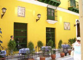 Hostal Valencia Old Havana Reviews - When entering the Hostal Valencia, you traverse through the impressive colonial portals to its large hallway.
