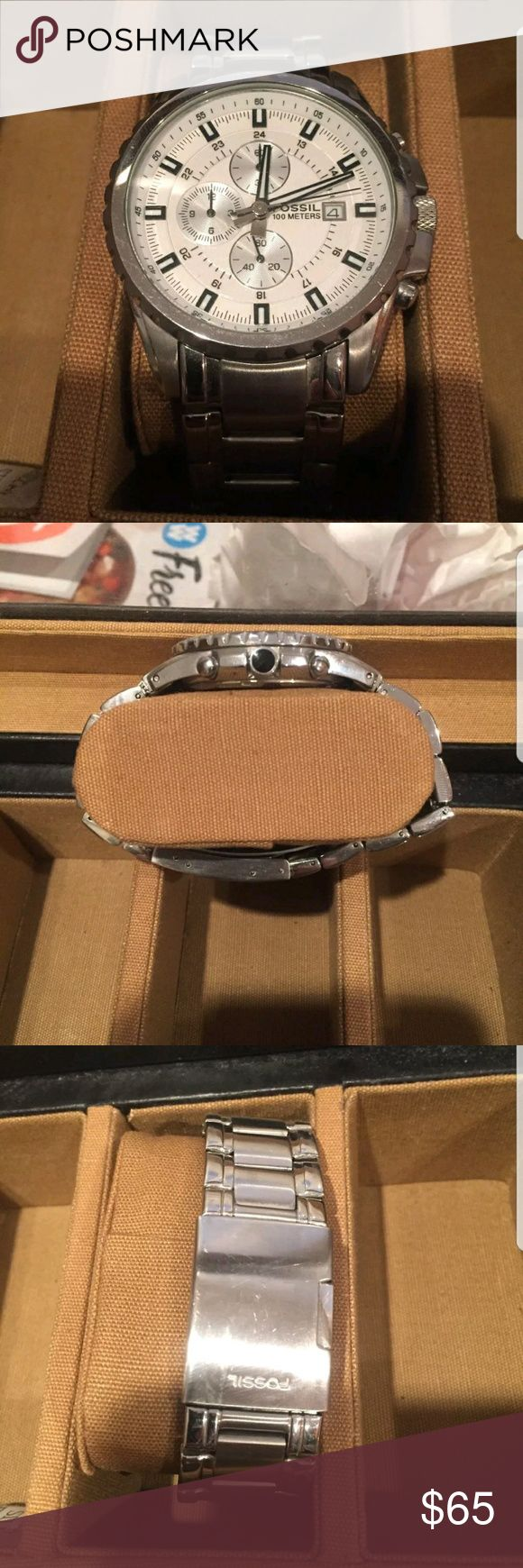 Fossil watch This is a lightly used men's Fossil wristwatch. The face is white with black accents and it has working chronograph dials. Watch was lightly worn and has slight wear marks on bottom of bracelet. Fossil Accessories Watches #menswatchesfossil