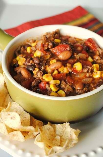 1lb hamburger meat, 1 can corn, 1 can diced tomatoes, 1 can pinto beans, 1 pkg Old El Paso (original) seasoning, 1 pkg  Hidden Valley Ranch Seasoning (original).   Brown and drain hamburger meat.  Combine all ingredients in large pot (use all juice from each can).  Serve with cheddar cheese, sour cream and corn chips.