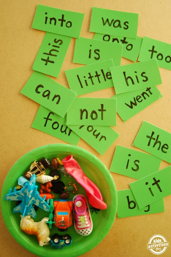 Free printable with sight word flash cards.  It's a reading game that kids can use to help them learn to read - using their toys.