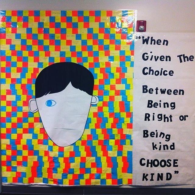 WONDER hallway display features positive sticky notes. The entire grade 9 each got a sticky note to write something. #choosekindness #wonder