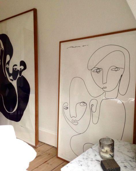 Large framed prints leaning against the floor