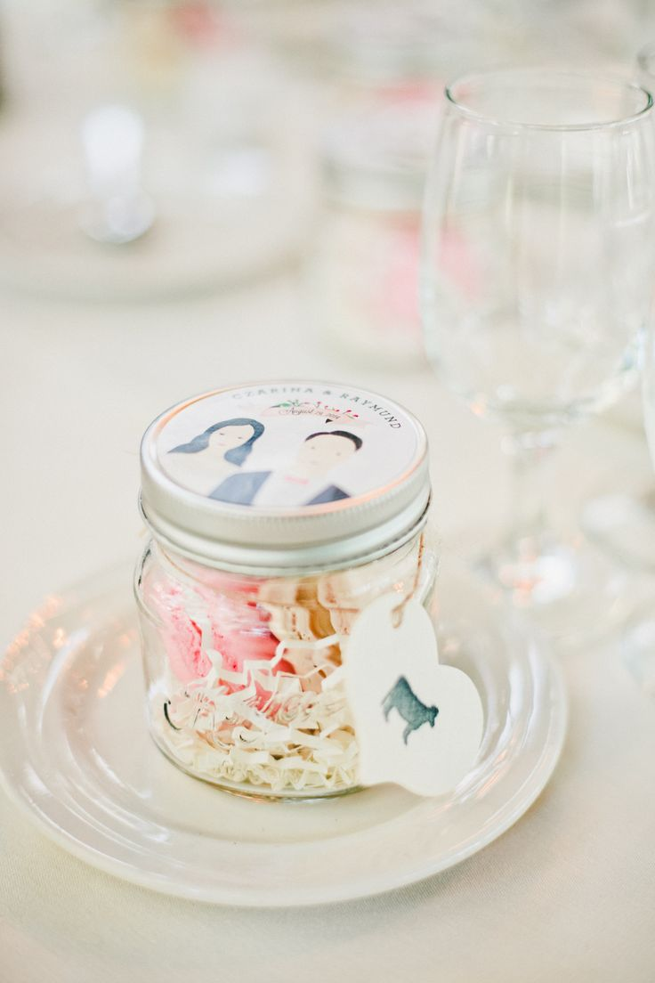Personalized mini mason jars with macaroons.