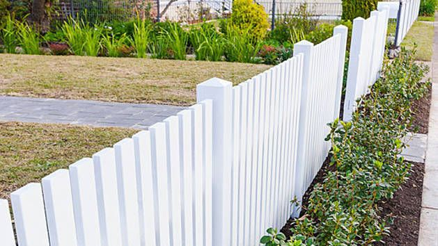A white picket fence is a classic front-yard look, and it works just as well with a country house as a city one. They are straightforward to build and you can save a fair amount of cash by doing it yourself. The pickets themselves can be fancy or plain, like those we chose to suit this 1970s-era house.
