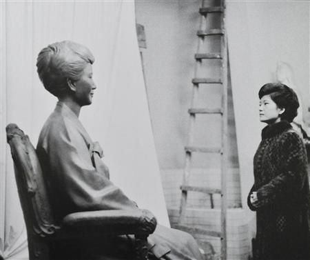 Park Geun-hye looks at a statue of her mother, Yuk Young-soo, commissioned as a tribute to the assassinated first lady, Seoul, South Korea, 1977, photograph by South Korea's Ministry of Culture, Sports and Tourism (photographer unattributed). Park would herself be elected president of South Korea in 2012.