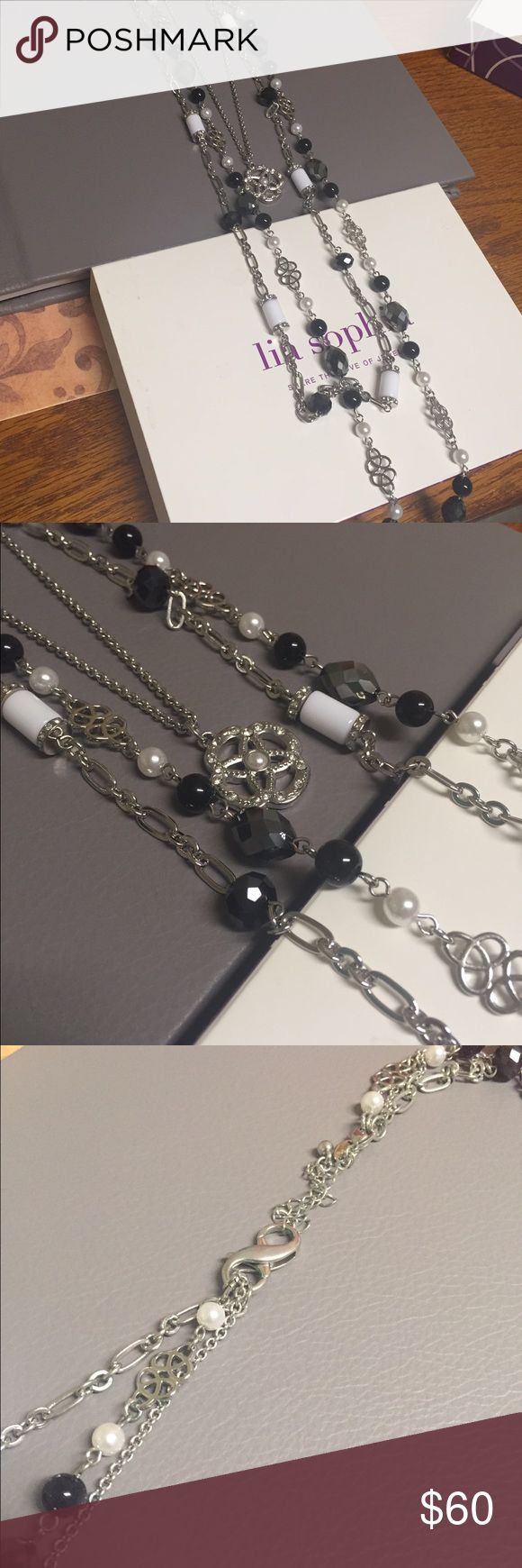 Lia Sophia 3 in 1 necklace This is the 3 in 1 Lia Sophia necklace. It has 3 chains that hook together on the clasp. This is beautiful and one of my favorites. Comes with the box, worn a few times, excellent condition!Sad to let it go! 💕 Lia Sophia Jewelry Necklaces