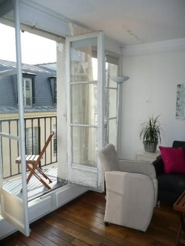 2nd Arrondissement Bourse apartment rental - Windows open up to the balcony with view of Paris roof tops. Approx S$250 per night.
