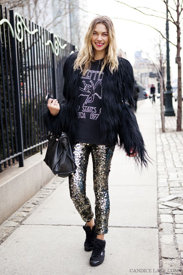 11 cool girl new year's eve outfit ideas - black fur coat, led zeppelin graphic t-shirt, gold sequin pants + black sneakers