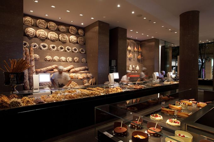 Blé Bakery on Agias Sofias in Thessaloniki, Greece, was designed by the minimalist architects at Claudio Silvestrin Giuliana Salmaso (London & Milan). It has the world's largest wood oven – gigantic, at 12 meters. Yum....