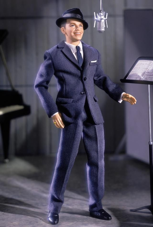 Frank Sinatra - The Recording Years -  Frank Sinatra wowed audiences for generations with his signature song style and his dashing good looks. This authentic doll captures the Chairman of the Board at the height of his recording career. Dressed in a dapper 1950s-style suit and tie, this doll authentically captures Frank Sinatra's likeness, thanks to incredible face sculpting and face paint. Doll even comes with Sinatra's signature pinky ring sculpted onto his right hand.