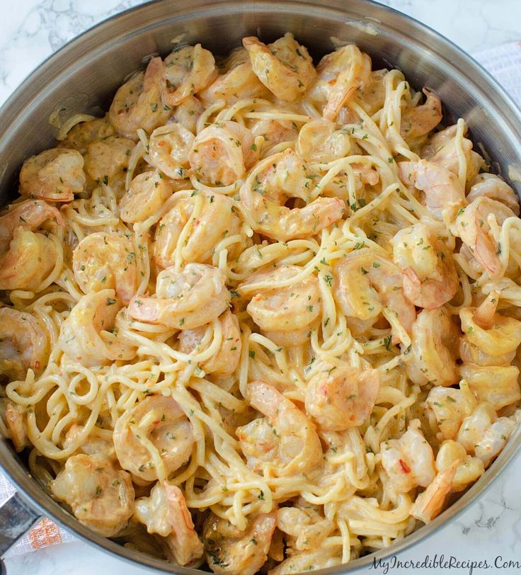 This Bang Bang Shrimp Pasta only takes 20 minutes to make and has perfectly seasoned shrimp in a delicious pasta with cream sauce that tastes amazing! via @bestblogrecipes
