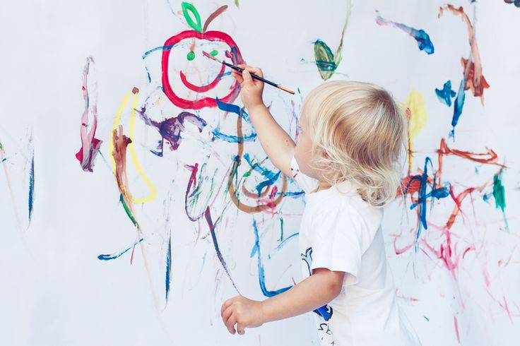 Child painting a Nordic Foodie apple