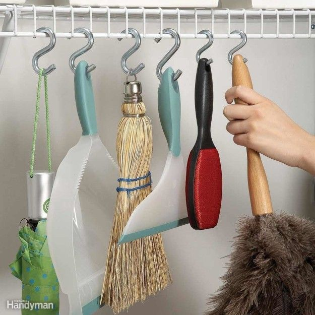 Turn those builder-grade shelves into convenient storage space using S-hooks from the hardware store.