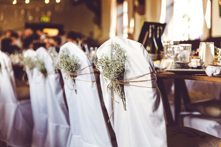 Wedding chairs decorated with bunches of gyp. Photography by Ash James.