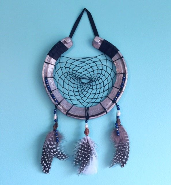 Horseshoe dream catcher with glass pearl and seashell accents by EarthDiverCreations on Etsy https://www.etsy.com/ca/listing/473732710/horseshoe-dream-catcher-with-glass-pearl