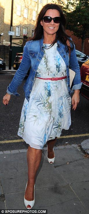 Casual additions: Susanna Reid covered up her pretty summer dress with her beloved denim j...