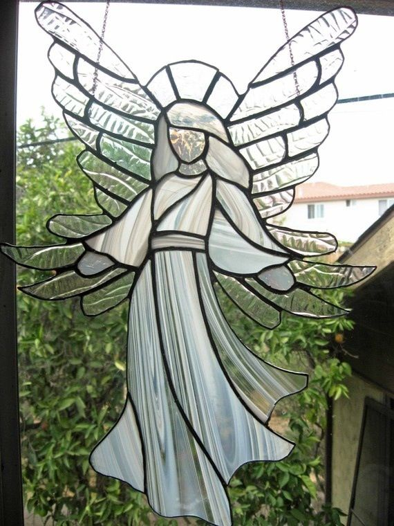 Gorgeous stained glass angel with flowing white gown and fabulous wings.