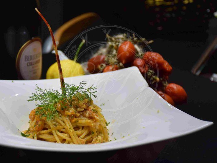 Spaghetti al ragù di aragosta e pomodorini del Piennolo