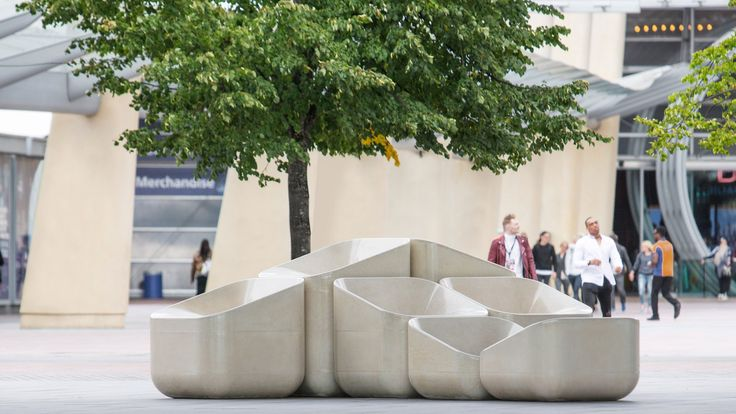 "Raw Edges has created a range of concrete street furniture for London's Greenwich Peninsula, which is designed to look like ""scaled-up"" armchairs"