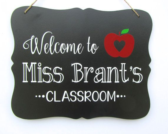 This adorable teacher door sign is the perfect gift for teacher. The chalkboard teacher sign is personalized with the teachers name. If you are looking for a great gift for teacher, this teacher sign is it! The sign hangs from jute rope and will dress up any teacher door or classroom.  Your choice of apple: heart apple (as shown), chevron apple, or solid apple. Please leave the teachers name in the notes to seller so I can personalize this teacher door sign.  The dimensions of this teacher…