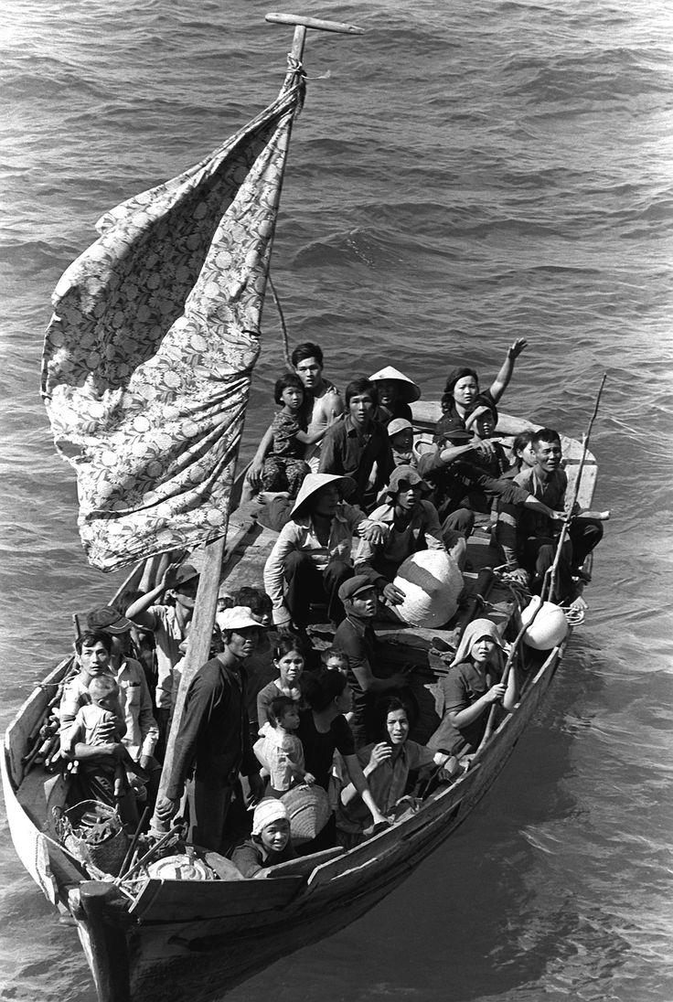 35 Vietnamese refugees wait to be taken aboard the amphibious command ship USS BLUE RIDGE (LCC-19). They are being rescued from a 35 foot fishing boat 350 miles northeast of Cam Ranh Bay, Vietnam, after spending eight days at sea.