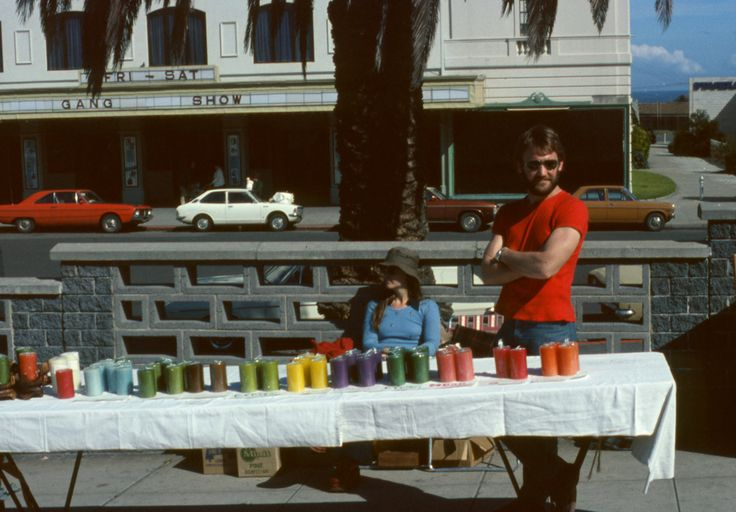 Chris & Maureen Phillips selling candles at a market stall circa early 1970's.  St Kilda Esplanade across the road from the beach and Luna Park.