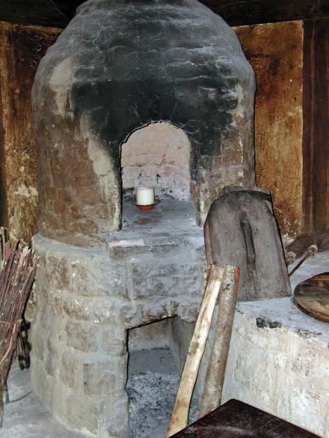 Tudor kitchen has been equipped with a bread oven and a copper for providing a constant supply of hot water are added, together with a woodstore for the fuel for the fires.