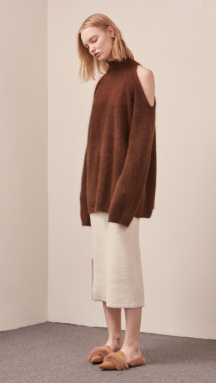 The Fella Sweater in dark brown. Features rolled neckline, long sleeves, drop shoulder, deep shoulder slits. Pull on. Relaxed silhouette. CO\MPOSITION AND CARE Hand wash warm, dry flat or dry clean Pl