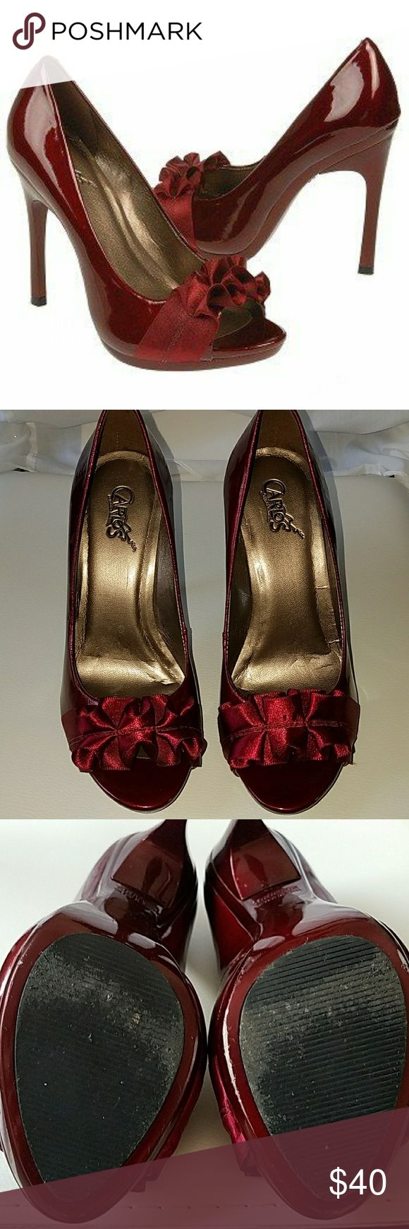 Carlos Santana Ruby Red Heels Patent leather high heels worn once for a wedding. Beautiful ruby red color and 4 in. heel. They are in great condition and just need someone else with smaller feet to love them! Carlos Santana Shoes Heels