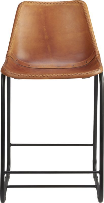 "Shop roadhouse 24"" leather counter stool.   Handmade leather composite with natural hide tones and markings saddles a contoured seat edged with a handsewn whipstitch and brass-painted rivets."