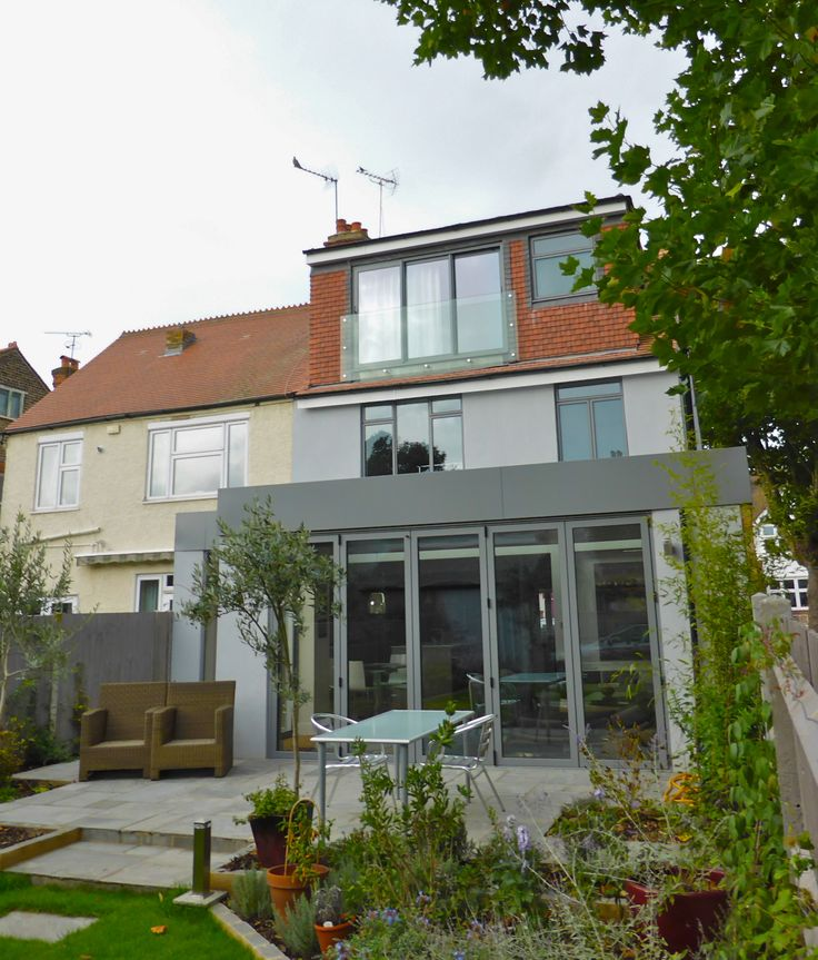 House extension in Barnes Favouring pale grey doors and windows at the moment If youre going to have a Juliette balcony in the loft it might as well be sheer glass for balustrading