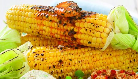 Paprika and parsley mielies (corn). Typical South Arican braai side dish. Lekker