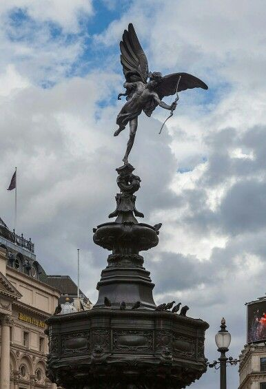 The Piccadilly Circus statue-topped fountain - completed 1893 - height 36 feet above the surrounding road level