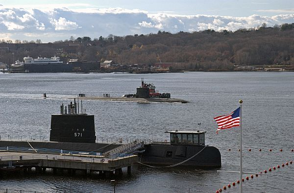 GROTON, Conn. (Dec. 1, 2009) The Los Angeles-class attack submarine USS San Juan (SSN 751) passes the historic Navy submarine, Nautilus, en route to Naval Submarine Base New London. San Juan made an historic first visit by a U.S. submarine to the South African city of Simons Town and also conducted the first-ever exercises between the U.S. and South African navies. San Juan is returning from a six-month deployment.