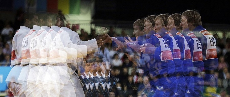 Hungary's Barna Bor and Morocco's El Mehdi Malki in men's judo  competition -multiple exposure2