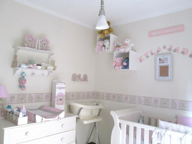 Pink and cream scruffy jungle nursery decor, complimented with a sleigh cot.