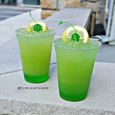 GREEN GOBLIN Midori Peach Schnapps Pineapple Juice Sour Mix Green Apple Vodka…