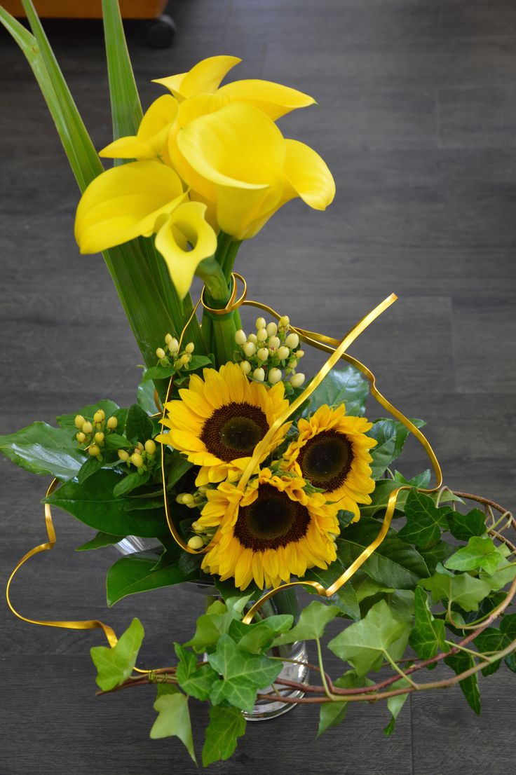 Yellow  Calla Lilies, Sunflowers , Flax , Ivy Trails etc
